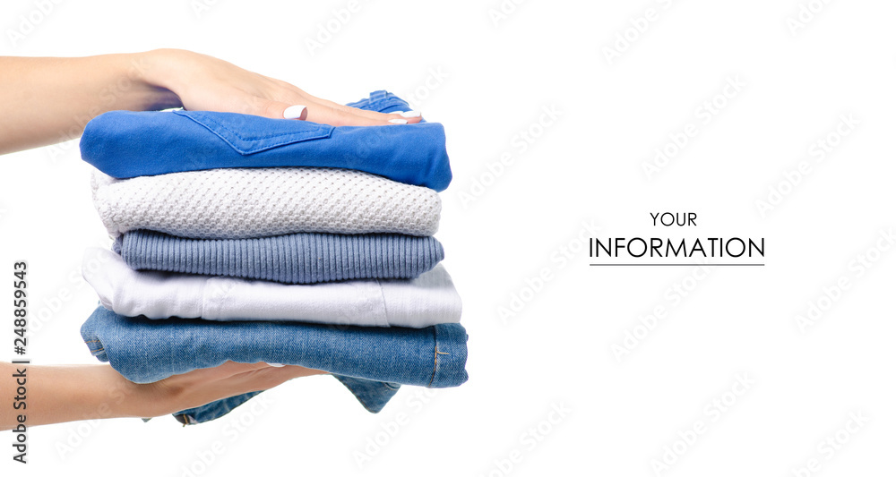 Fototapety, obrazy: Stack of clothing jeans sweaters in hand pattern on a white background isolation