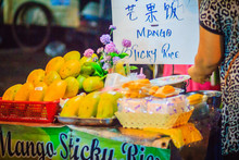 Bangkok, Thailand - March 2, 2017: Mango With Sticky Rice And Fresh Fruit Juice Are The Popular Street Foods At Khao San Road Night Market, Bangkok, Thailand.