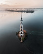 Aerial view of abandoned belfry on the lonely island on the Volga river. Russia. Kalyazin. Russian churches.