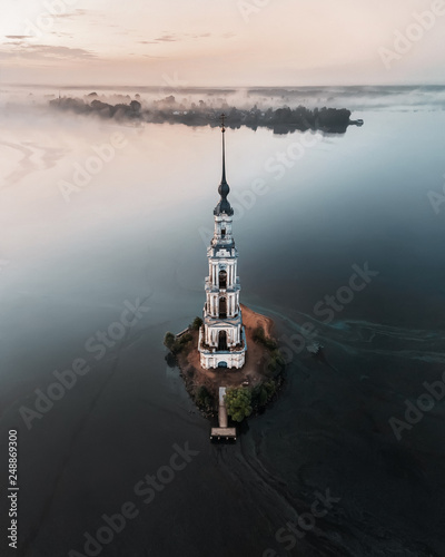 Aerial view of abandoned belfry on the lonely island on the Volga river Fotobehang
