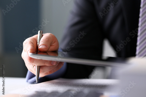 Fototapety, obrazy: Businessman arm in suit and tie use silver pen and pad pc
