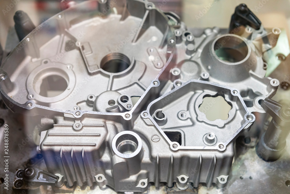 Fototapety, obrazy: Close up Industrial aluminum casting parts cover crankcase or cylinder block of vehicle automobile or motorcycle set up on work table of machine