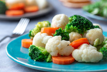 Steamed Broccoli, Cauliflower And Carrots. Healthy Food.