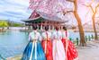 Leinwanddruck Bild - Cherry Blossom with Korean national dress at Gyeongbokgung Palace Seoul,South Korea