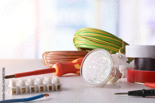 Fotografia  Composition with electrical material and window front view