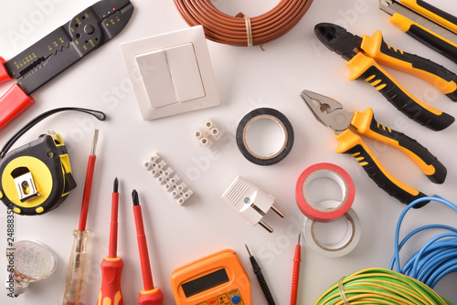Tools and electrical material on a white table top general - 248883510