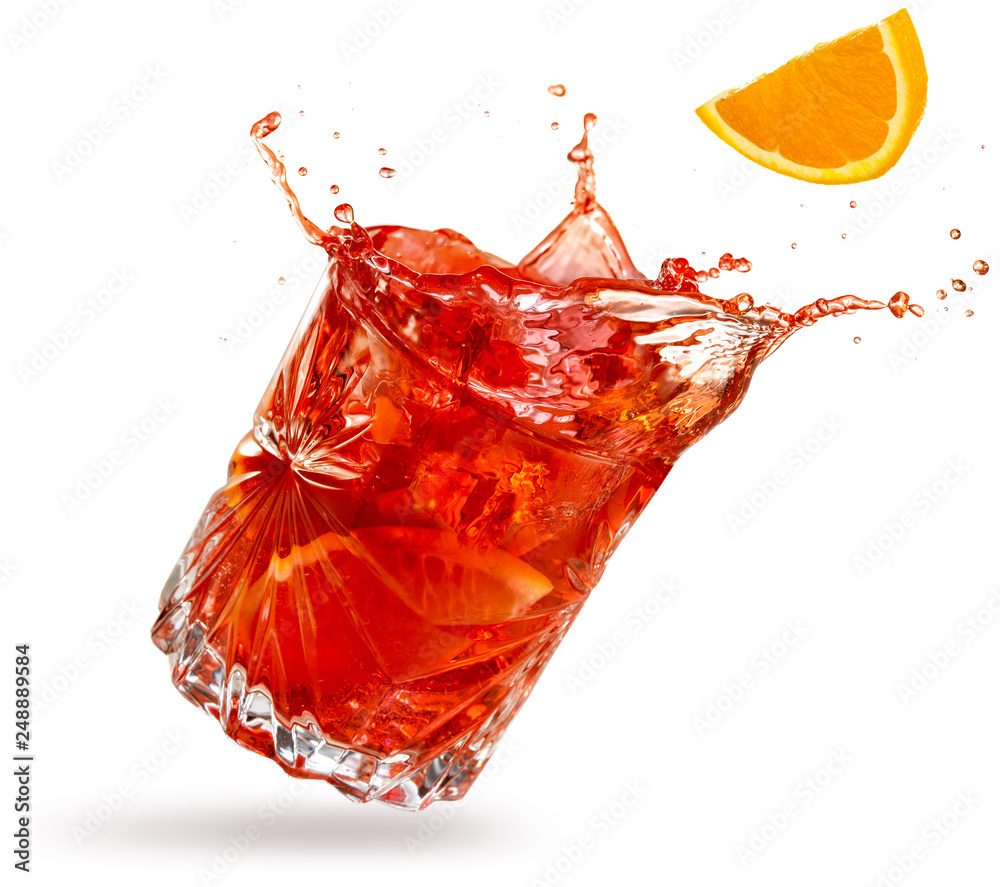 Fototapety, obrazy: orange slice falling into a splashing negroni tilted on white background
