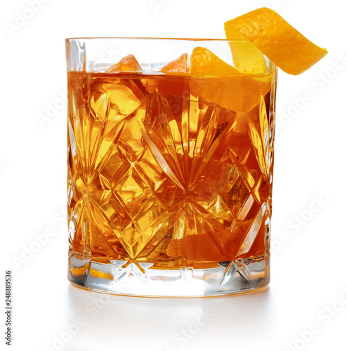 Obraz old fashioned cocktail garnished with orange twist peel isolated - fototapety do salonu
