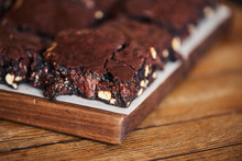 Freshly Baked Gooey Chocolate Brownies Sitting On A Table