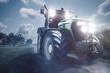 canvas print picture - Traktor fährt auf einem Feldweg bei Nacht