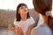 Leinwandbild Motiv Cute stuttering child girl speaking doing exercises with speech therapist