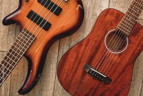 What to choose? Top view on two cool musical instruments: acoustic and electric Canvas Print