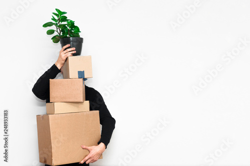 Man with box moving in a new apartament. Moving concept. Canvas Print