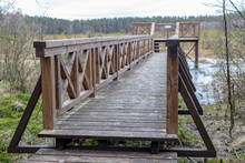 A Solid Wooden Bridge Over The...