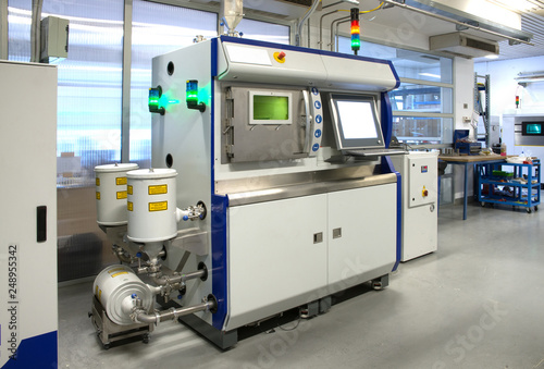Obraz na plátně  Metal 3D printer (DMLS) - Direct metal laser sintering (DMLS) is an additive manufacturing technique that uses a laser fired into a bed of powdered metal