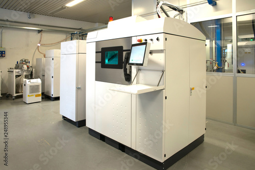 Fotografie, Obraz  Metal 3D printer (DMLS) - Direct metal laser sintering (DMLS) is an additive manufacturing technique that uses a laser fired into a bed of powdered metal