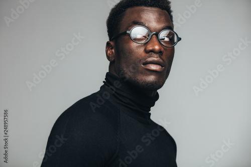 Thoughtful african man staring away