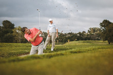 Golfer Hitting The Ball Out Of A Sand Bunker