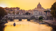 The Dome Of Saint Peters Basilica And Vatican City At Sunset. Sant'Angelo Bridge Over The Tiber River. Rome, Italy