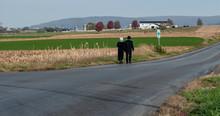 Amish Couple Walking 2