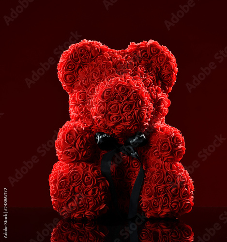 Red bear of roses present gift for valentines day or woman birthday