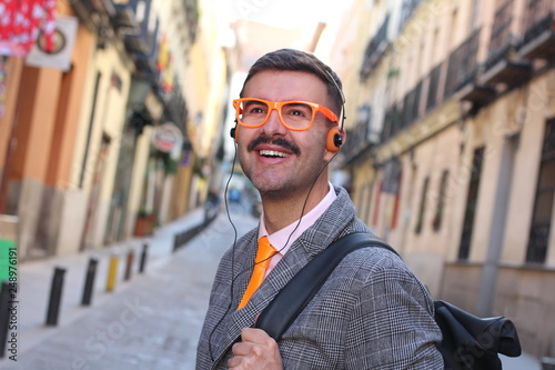 Photo  Hipster businessman listing to music