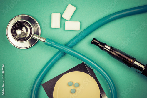 stethoscope and nicotine patch, chewin gum and ecigarette used for smoking cessation