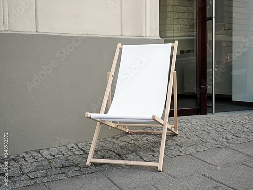 Tableau sur Toile Mock up, Blank Sunbed, deck chair in a front of a shop on a pedestrian path in t