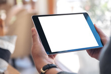 Mockup Image Of A Woman's Hands Holding Black Tablet Pc With Blank White Screen Horizontally While Sitting In Cafe
