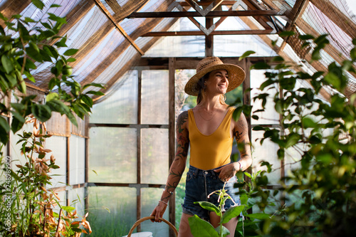 Fototapeta Beautiful woman in a greenhouse
