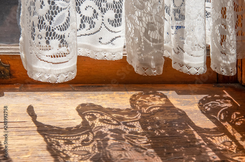 Fényképezés  Lace curtains in an old house - bottom of curtains hanging on French door with t