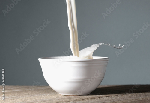 Fotografie, Obraz  Bowl of MIlk Being Poured and Splashing Out