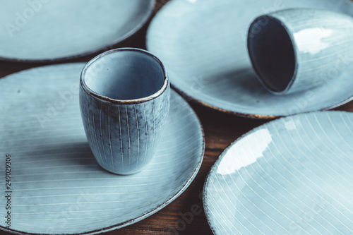 Canvas Print Handmade blue set of ceramic tableware. Espresso cups and plates.