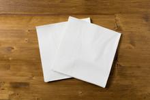 White Paper Napkin On Wooden Background.