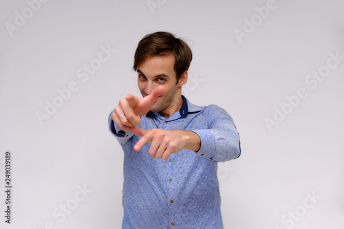 Fotografie, Obraz  Concept studio portrait of a handsome young man isolated on a white background w