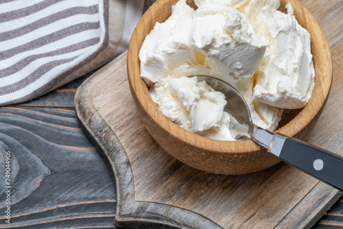 Valokuvatapetti Traditional Mascarpone cheese in wooden bowl on table