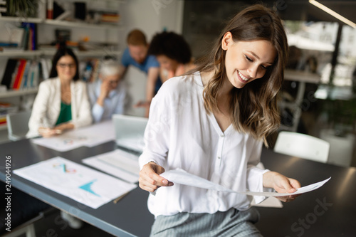 Business woman with her staff, coworker people group in background at office