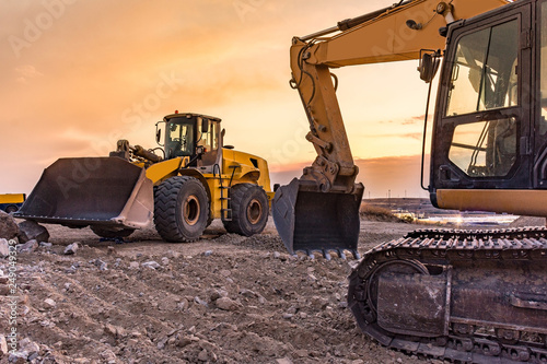 Photo  Group of excavator working on a construction site