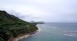 Aerial: Mountain beach and ocean on a overcast day