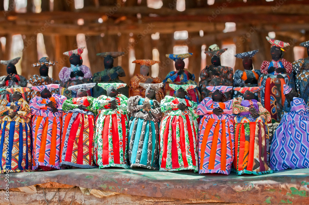 Fototapeta Herero dolls souvenir for sale on a stall in Windhoek Namibia south west Africa.