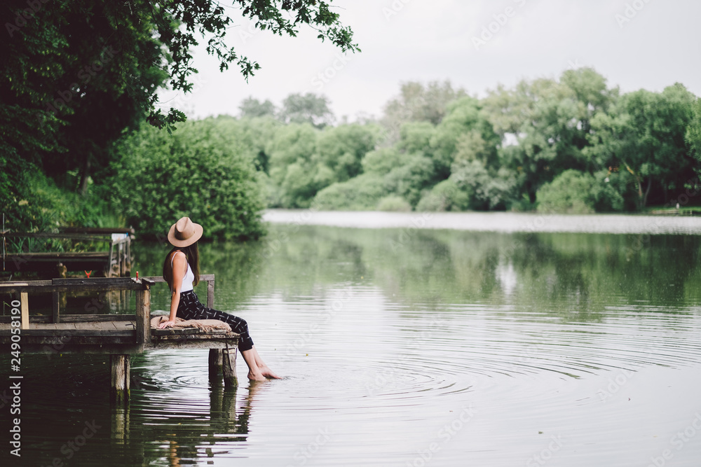 Fototapety, obrazy: Relaxing woman at a summer lake in forest