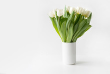 Bouquet Of White Tulip In Vase On White. Space For Text.