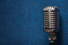 A Professional, Shiny Modern Dynamic Studio Vocal Microphone On A Stylish Dark Blue Grunge Vintage Background Texture. Singing And Recording, Stage Show Concept.