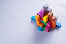 Abstract Construction From Wooden Blocks. Colorful Wooden Building Blocks.
