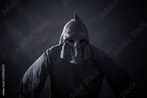 Scary figure in hooded cloak Fototapeta