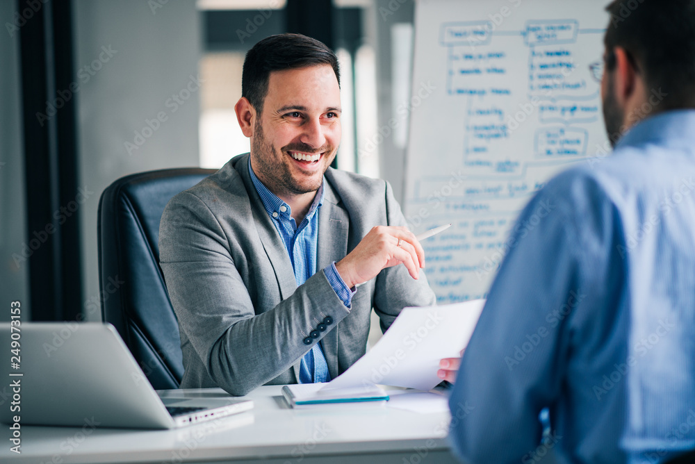 Fototapeta Handsome hr talking to a job candidate.