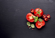 Fresh  Tomatoes With Pepper And Basil On Black  Stone Background