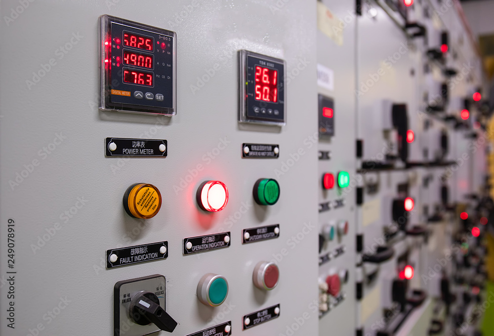 Fototapeta Electrical switch gear at Low Voltage motor control center cabinet  in coal power plant. blurred for background.