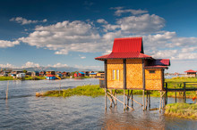 A House On Bamboo Sticks In In...