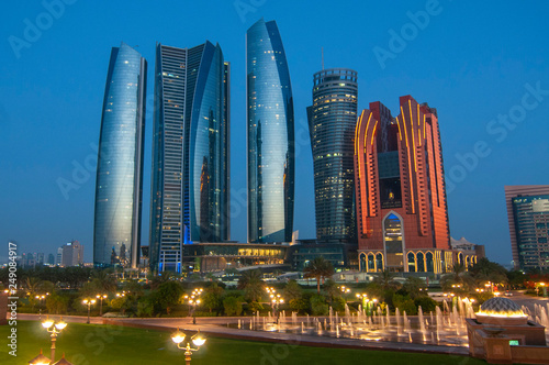 Poster Abou Dabi Skyscrapers of Abu Dhabi at night with Etihad Towers buildings. Abu Dhabi is the capital and the second most populous city of the United Arab Emirates.